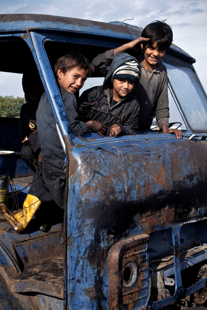 Teen-aged automobile mechanics service more than just cars. Lahore.