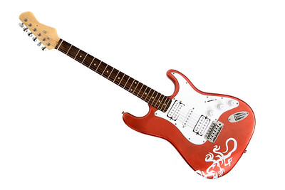 red electric guitar isolated over a white background