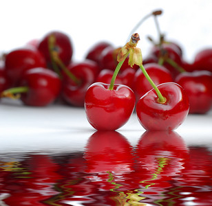 Fresh cherries on white with more cherries in background