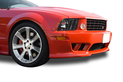 Front of red modern American muscle car on a white background