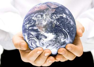 The globe in children's hands. Concept for environment conservation.