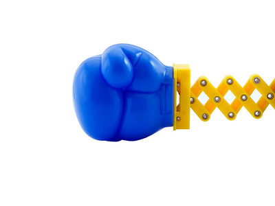 Photo of a boxing glove on a retractable arm, isolated on white
