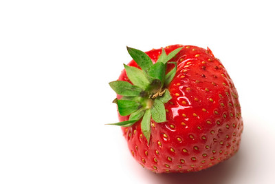 close-up of bright red strawberry with stone on a white background