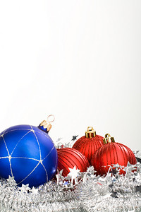 Christmas composition: blue and red balls with tinsel