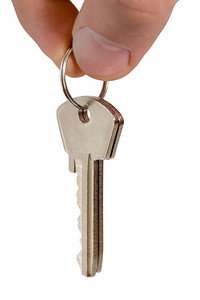 keys in fingers isolated on white (contains clipping path)