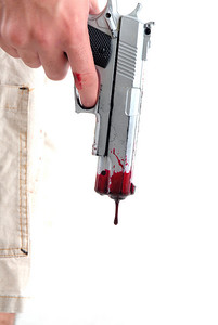 Toy weapon spilling tear of blood .