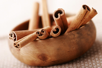 wooden bowl with cinnamon sticks