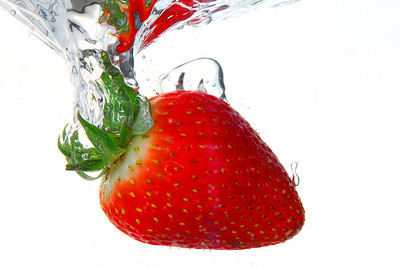Strawberry being dropped in to water