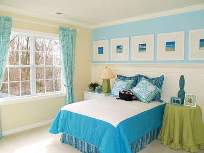 A very nicely decorated bright blue child's bedroom