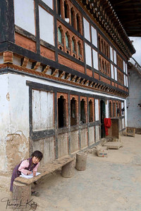 Student doing her homework.  Paro Valley, Bhutan.