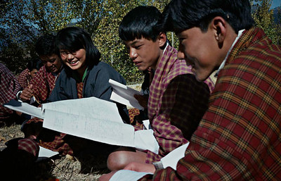 Students studying in nature. Paro Valley, Bhutan.