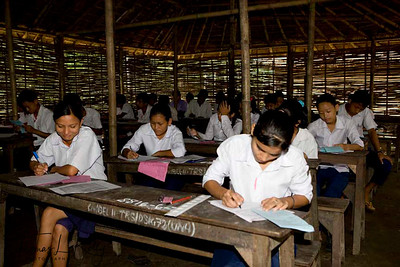 School kids of Bhutanese Refugee camps taking exam at Tri Ratna Secondary School. This school was established for the Bhutanese Refugees on 5th of April 1993. Education at Beldangi-II, Jhapa, is carried out by Caritas. Beldangi-II, Jhapa, Nepal.