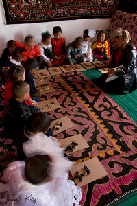 "In Kyrgyz kindergarten, students learn to make alphabets and numbers out of coloured lamb-bones. Here they make number ""7"". Satellite Kindergarten (SKG) in Kabylanlal, Kyrgyz Republic."