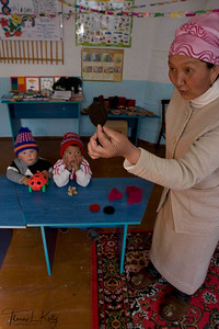 Students learn shapes like circle, square, triangle, hexagon etc; made out of felt. Satellite Kindergarten (SKG) in Kabylanlal, Kyrgyz Republic.