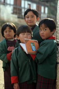 Bhutanese school girls in their traditional garb, kira. Paro Valley, Bhutan.