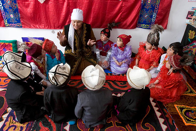 Grandmother narrates folk tales during brake times between classes. Satellite Kindergarten (SKG) in Kabylanlal, Kyrgyz Republic.