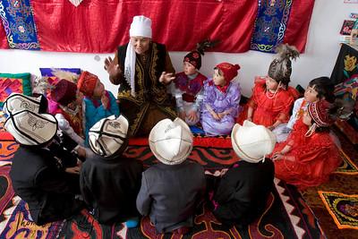 Grandmother narrates folk tales during brake times between classes. Satellite Kindergarten (SKG) in Kabylanlal, Kyrgyz Republic.