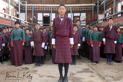 Early morning assembly in the courtyard of school Paro Valley. Bhutan.