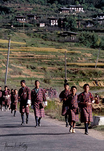 Bhutanese students in their traditional garb, gho. Paro Valley, Bhutan.