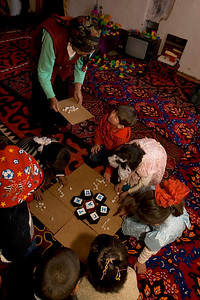Students use felt-shapes, coloured bone and alphabet cut outs at kindergarten. Satellite Kindergarten (SKG) in Kabylanlal, Kyrgyz Republic.
