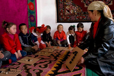 "In Kyrgyz kindergarten, students learn to make alphabets and numbers out of coloured lamb-bones. Here they make number ""1"". Satellite Kindergarten (SKG) in Kabylanlal, Kyrgyz Republic."