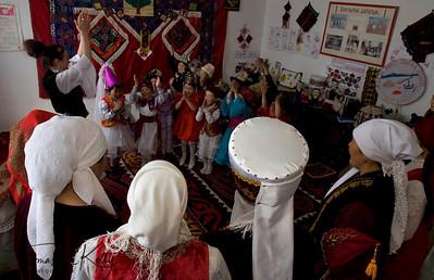 Mothers watch their children perform at music class. Satellite Kindergarten (SKG) in Kabylanlal, Kyrgyz Republic.