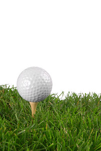 Golf ball close-up from the ground level with white background