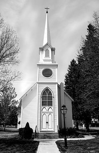 small cute white church in Carson City,  Nevada with steeple
