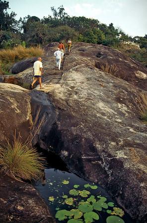 Nature walk to Therevadan Buddhist monastery above Ulpotha. Ulpotha, Sri Lanka.