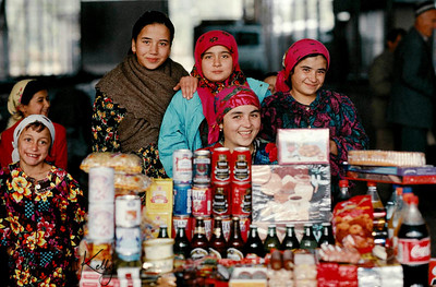 Young girls full of resilient with life itself, sells canned foods on behalf of their mother and family. They lost their father in the war. Tazikistan;Dushambee