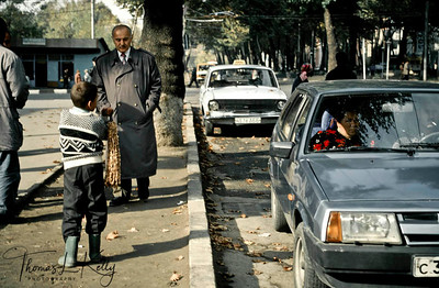 Little boys trying to sell off strings of Pistachio nuts for the family. Tazikistan; Dushanbee