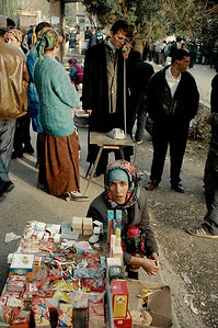 Dushambee market, some widows and their children make a living by selling corns, pastry and cigarettes on the pavement of a street. Tazikistan;Dushanbee