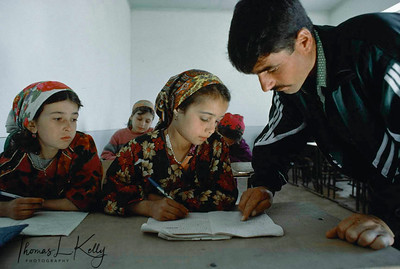 Save The Children/US runs a programme in Tajikistan helping out the widows and children with schools and with Saving and Credit Scheme and Health. These girls lost their father in war. They are given food and education by SCF-US. Kurgentubee, Tazikistan
