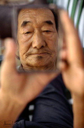OLD AGE REFLECTION. Tibetan Old PeopleÕs Home, Rajpur, India.
