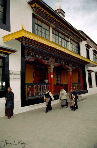 Tibetan Pilgrims circumambulate library in dharamshalla, India
