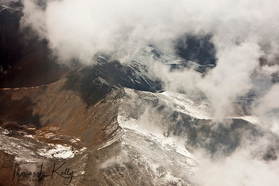 Aerial view of cloud and mountains while entering Tibet.