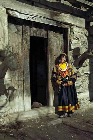 The kupas, the headdress of the women, is a mark of Kalash identity. Covered with cowrie shells, it is an appeal for protection and fecundity. No women may go bare-headed, without the kupas or at least without the headdress support, the shushut, which is also decorated with cowrie shells, beads, bells, buttons and pompoms. Chitral, Pakistan.