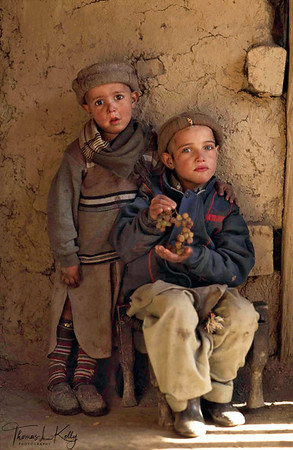 Kalash boys. Custom does not regulate the dress of Kalash men. They have simple adopted the Pakistani form of dress, the salwar-kamiz, a long cotton tunic worn over baggy trousers and a Chitrali cap. Chitral, Pakistan.