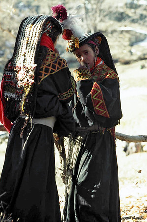The kupas, the headdress of the women, is a mark of Kalash identity. Covered with cowry shells, it is an appeal for protection and fecundity. No women may go bareheaded, without the kupas or at least without the headdress support, the shushut, which is also decorated with cowry shells, beads, bells, buttons and pompoms. Chitral, Pakistan.