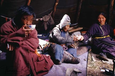 A hundred and four years old Shamanist, Suyan, inside teepee, with her daughter and son-in-law. Northern Mongolia