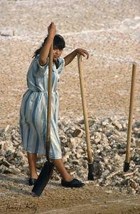 The Indigenous Wayuu woman working in  salt harvesting site.