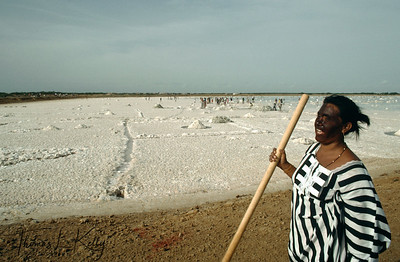 The Indigenous Wayuu woman working in  salt harvesting site.