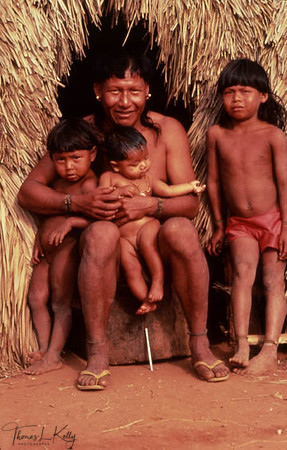 A Xavante man poses with his three sons.
