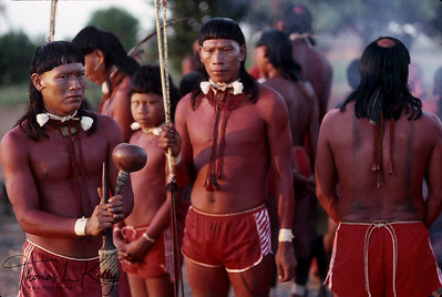 Xavante men rest during a more peaceful part of the initiation ceremonies.