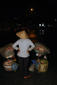 Vendor returning home after all day work at Ho Min Chi City in Vietnam. She wears a traditional conical hat called Non La.