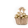 Gold Christmas wicker basket with balls and ribbons.