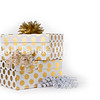 Christmas gift boxes with polka dots and ribbons on white background.