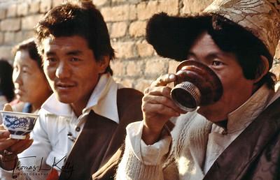 Tibetan refugees drinking Darjeeling Tea at Self-Help Refugee Center.  Darjeeling, India.
