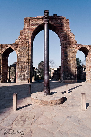 Iron pillar (7.2 metres high) of the Gupta age, called Vishnu-dhvaja, stands in the courtyard of the Quwwat-ul-Islam Mosque. New Delhi, India.