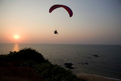 Paragliding at Anjuna Beach in Northern Goa. India. Situated eight kilometers west of Mapusa, Anjuna beach is the most happening of all beaches, one rather say its the mother of all beaches in Goa.